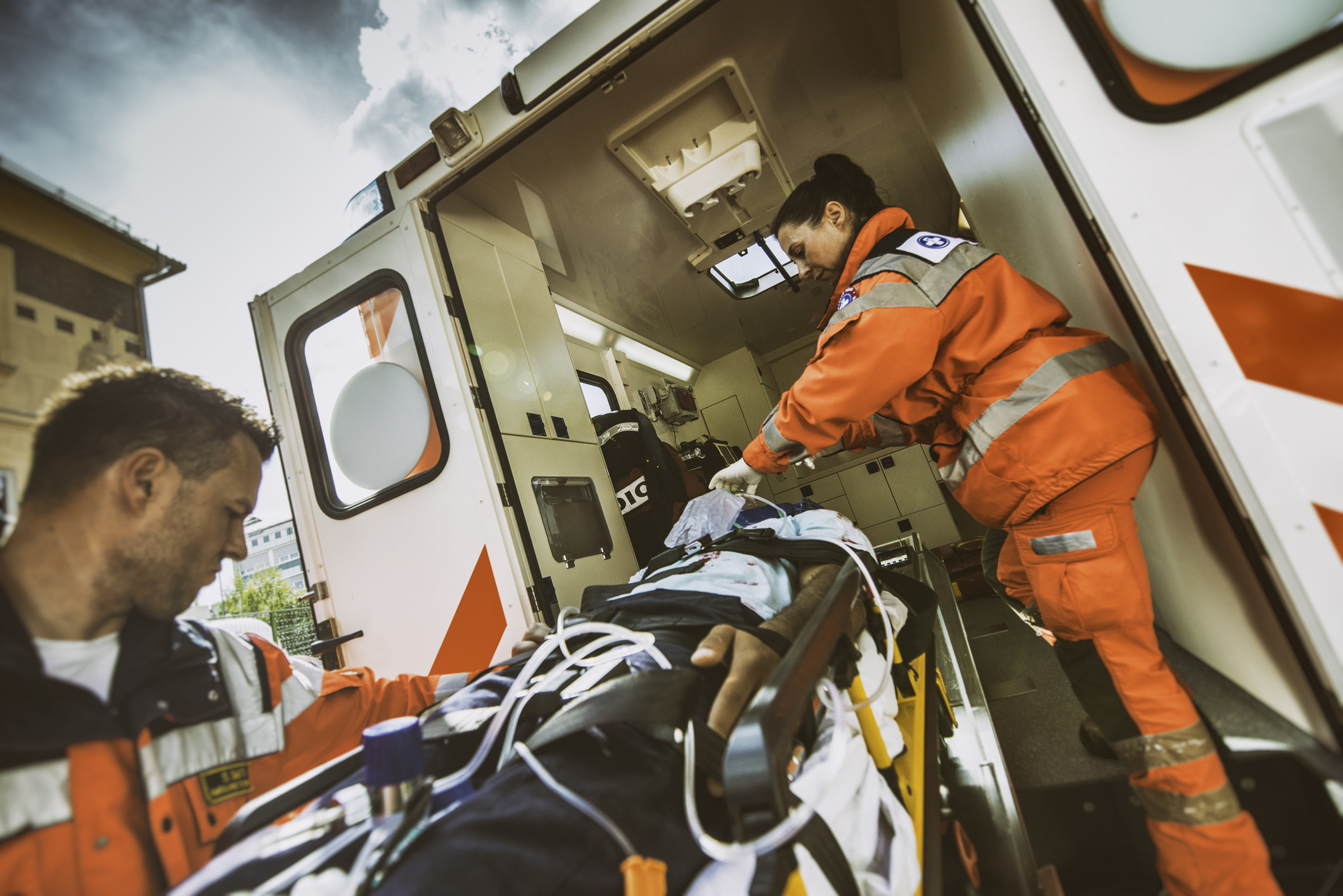 EMS workers loading a patient into an ambulance