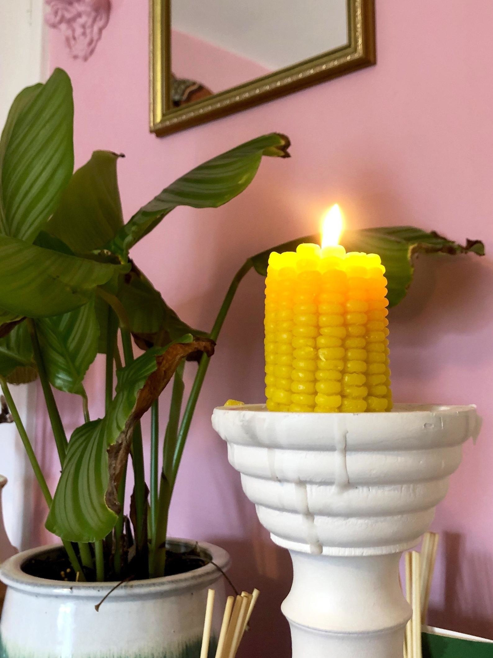 The lit corn candle