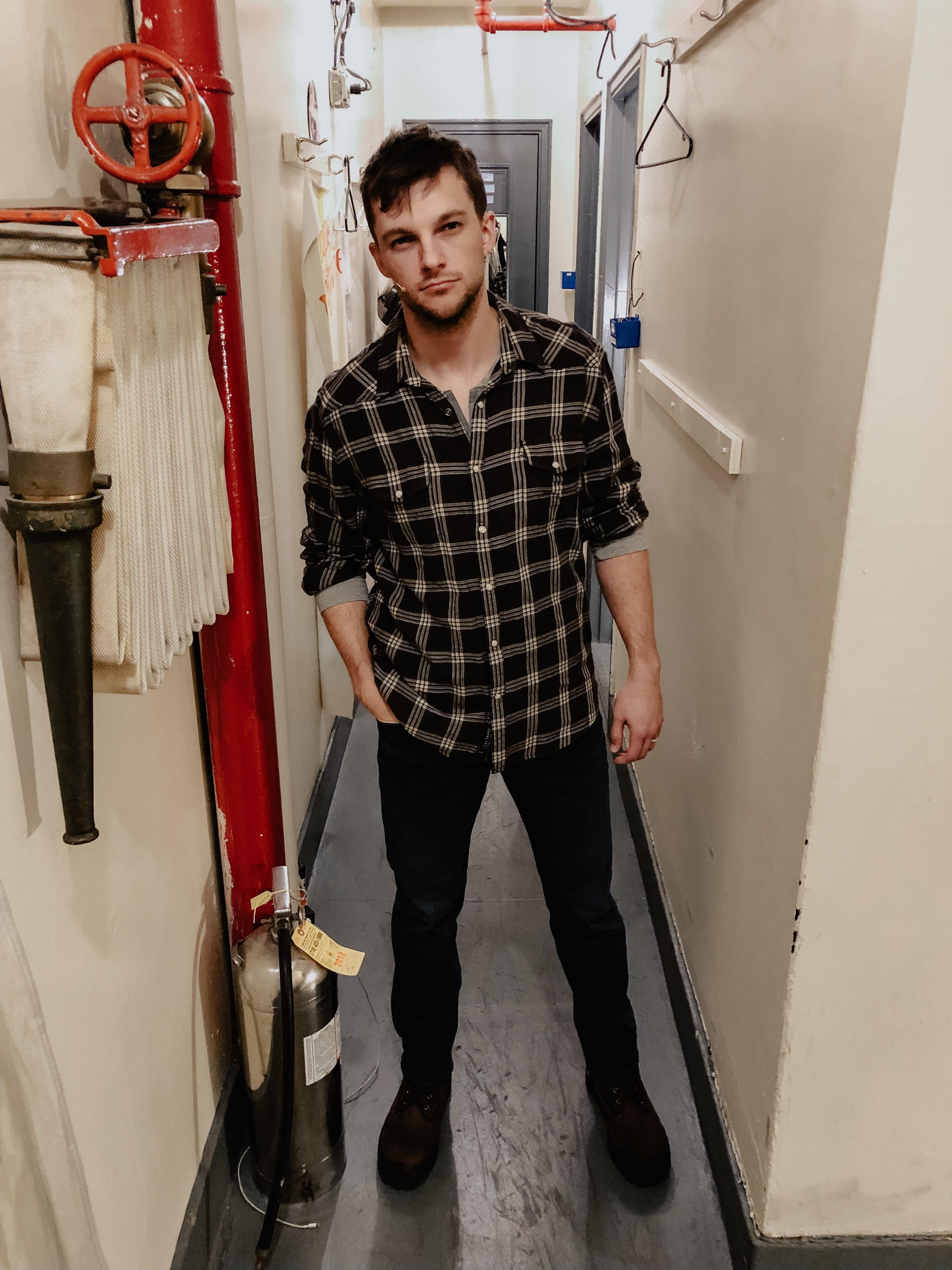 Dan posing backstage