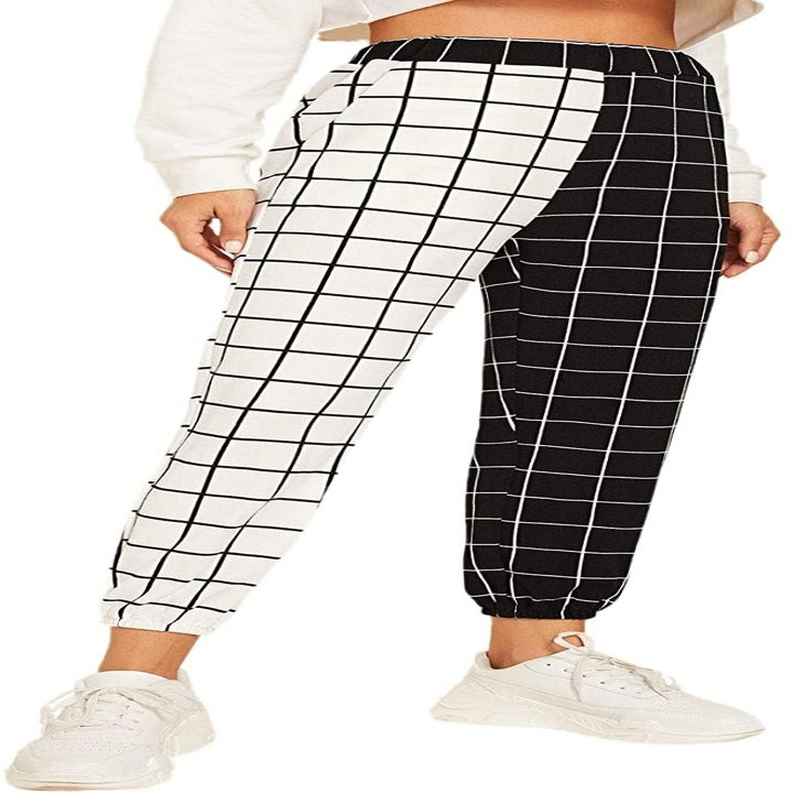 Another model wearing white and black two-toned checkered pants
