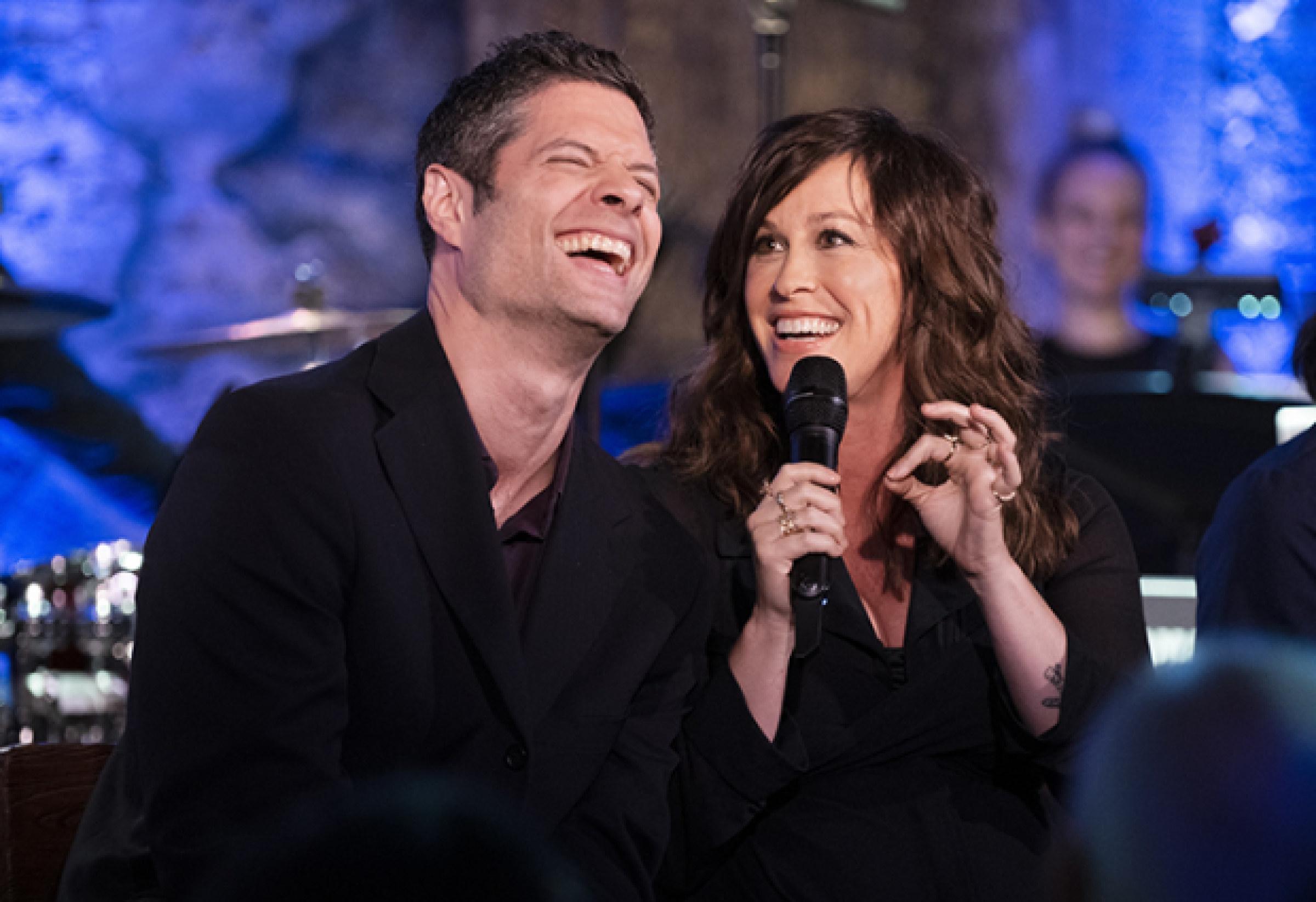 Tom Kitt laughing with Alanis Morissette