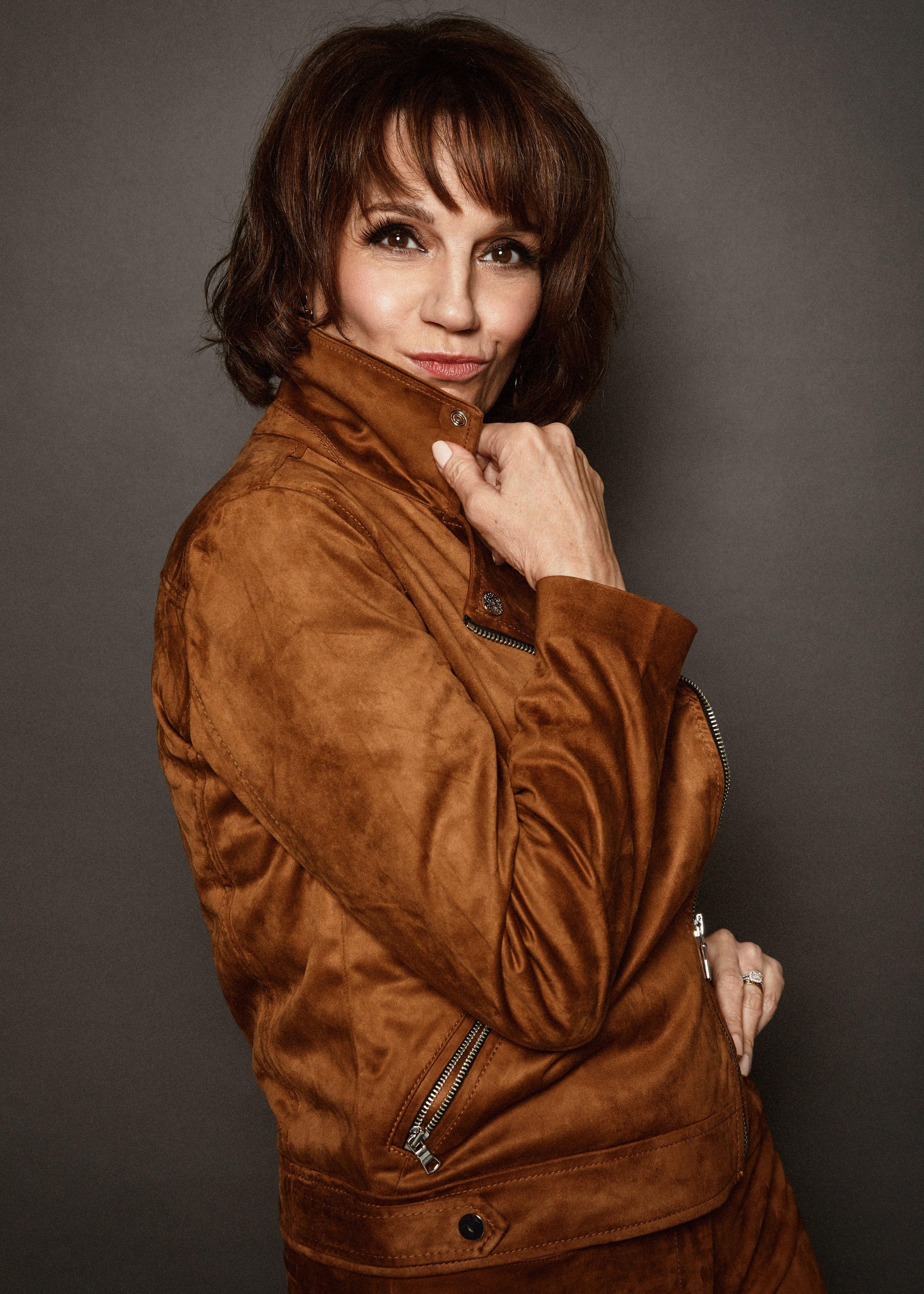 Beth posing in a suede jacket