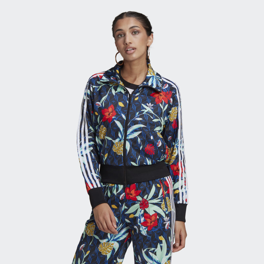 a model wearing the adidas floral track jacket