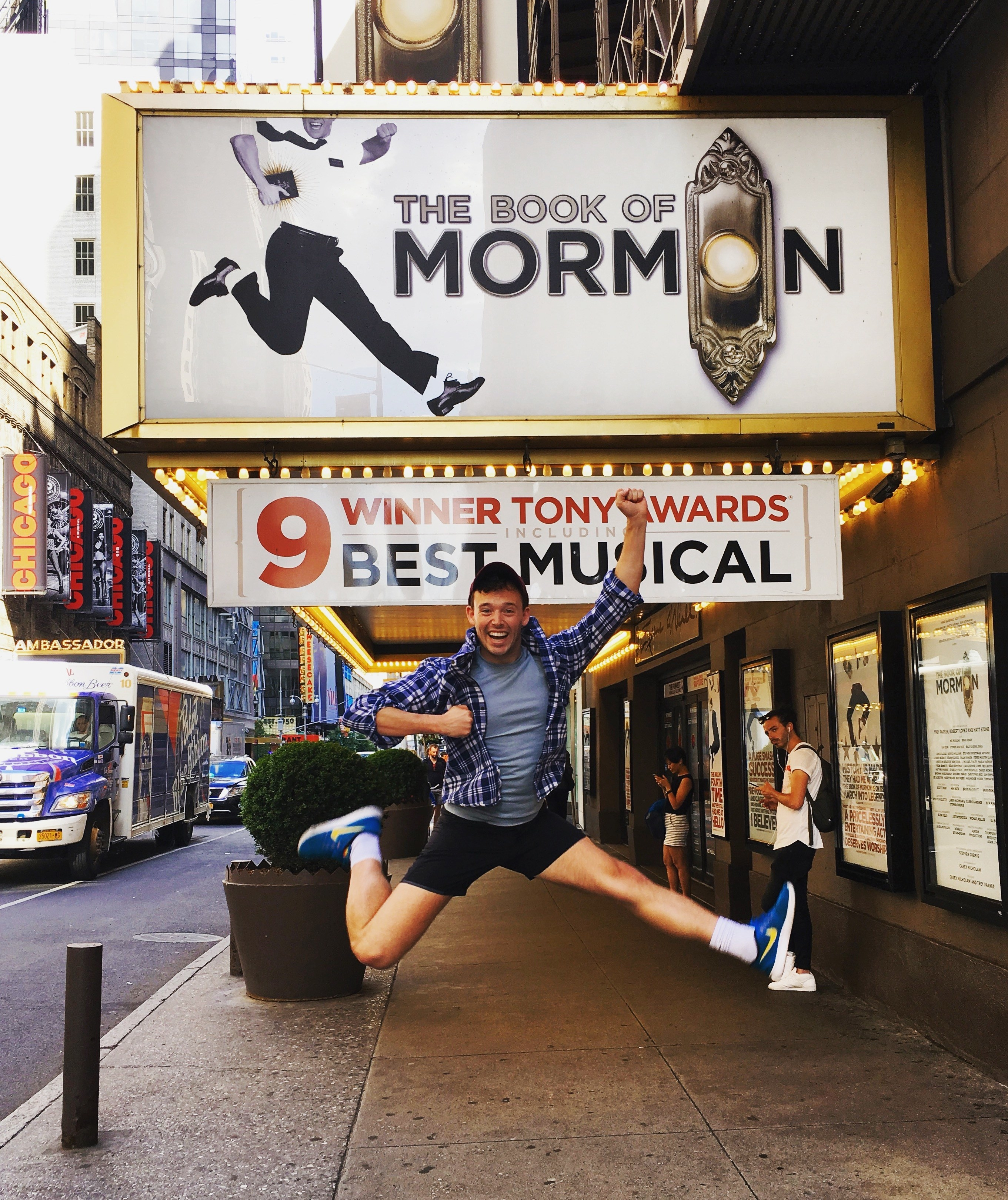 """JJ jumping in front of """"The Book of Mormon"""" theater marquee"""