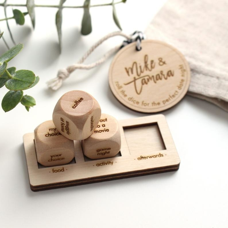 wooden dice with different activities and a tray with three labeled dice holders that say, food, activity, afterwards