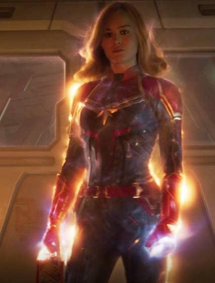 Orange energy flowing around Captain Marvel