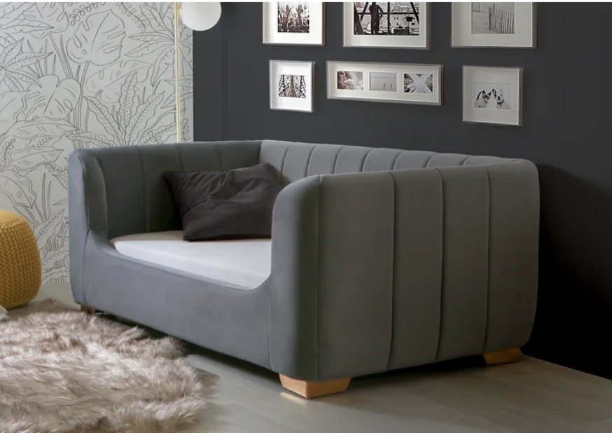 Gray sofa-style toddler bed with black pillow