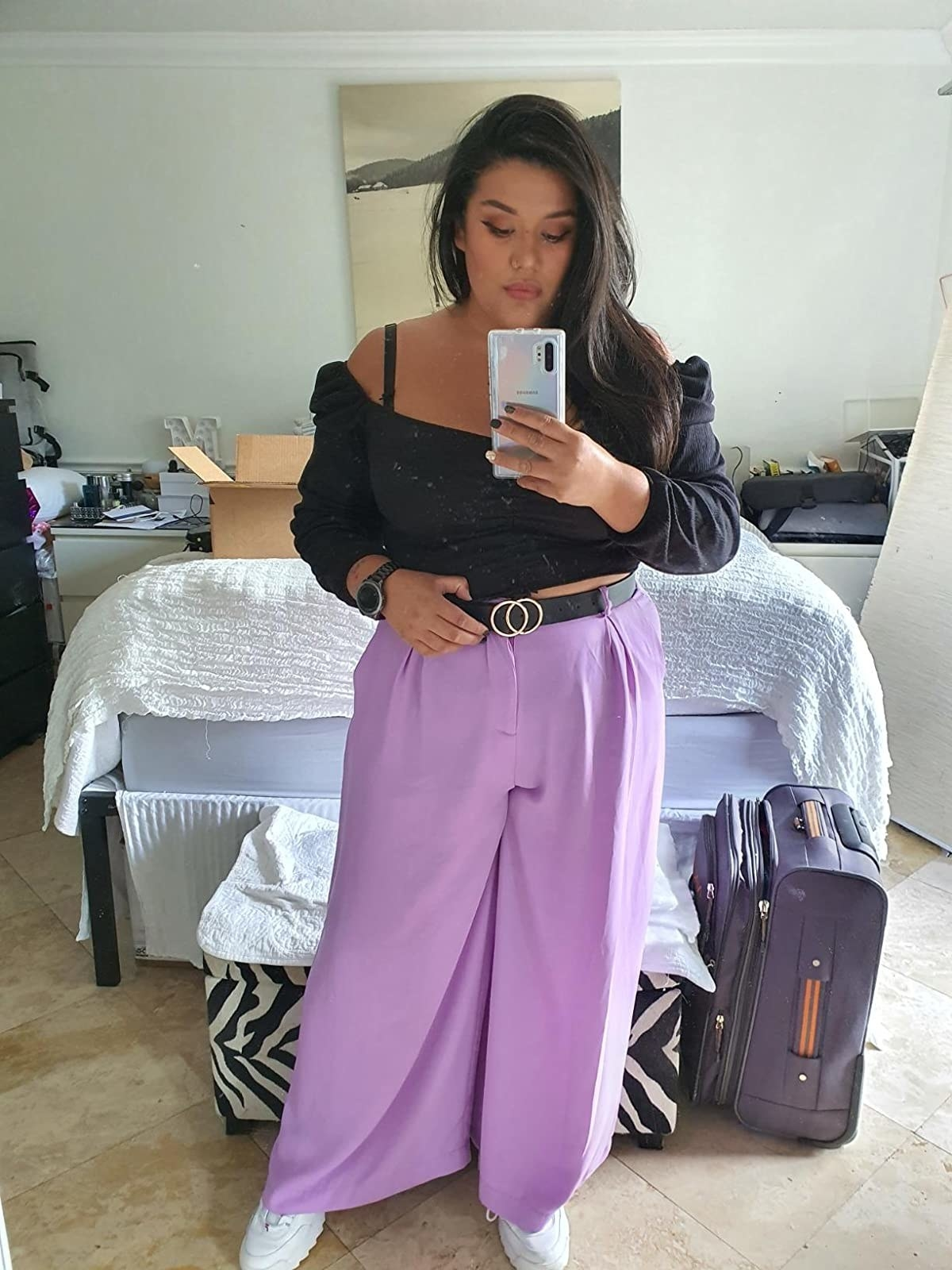 Reviewer wearing lilac pants