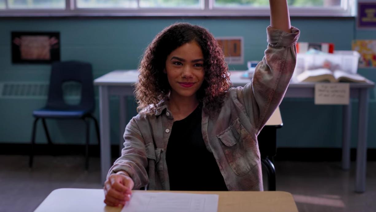Ginny raising her hand in English class