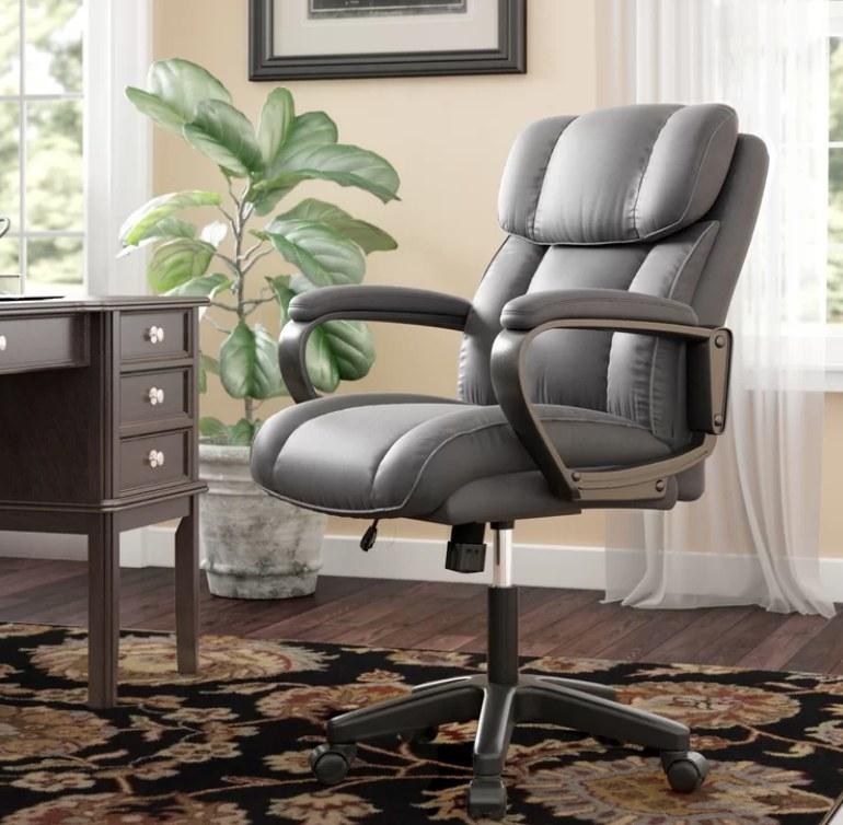 Gray cushioned swivel chair