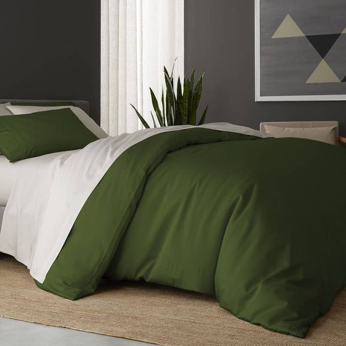 the sheet set in snow with a forest green duvet