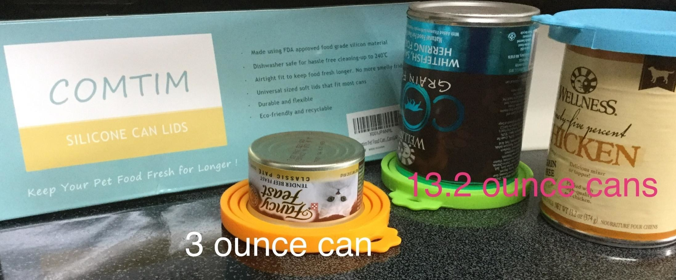 The silicone covers on a small 3-ounce can of cat food and two large 13.2-ounce cans of dog food