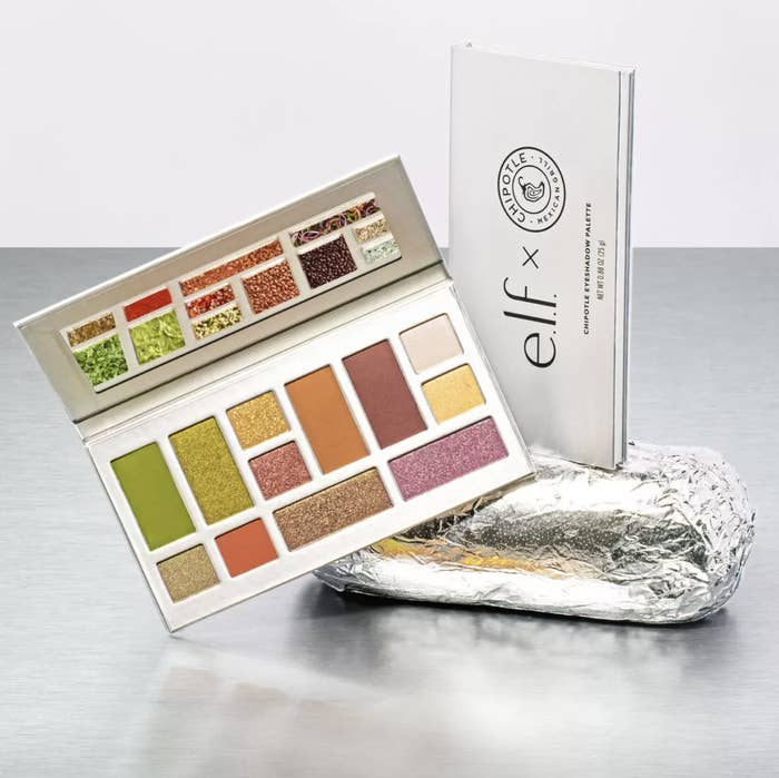 "A silver makeup palette sitting on a Chipotle burrito that says ""E.l.f. x Chipotle"""