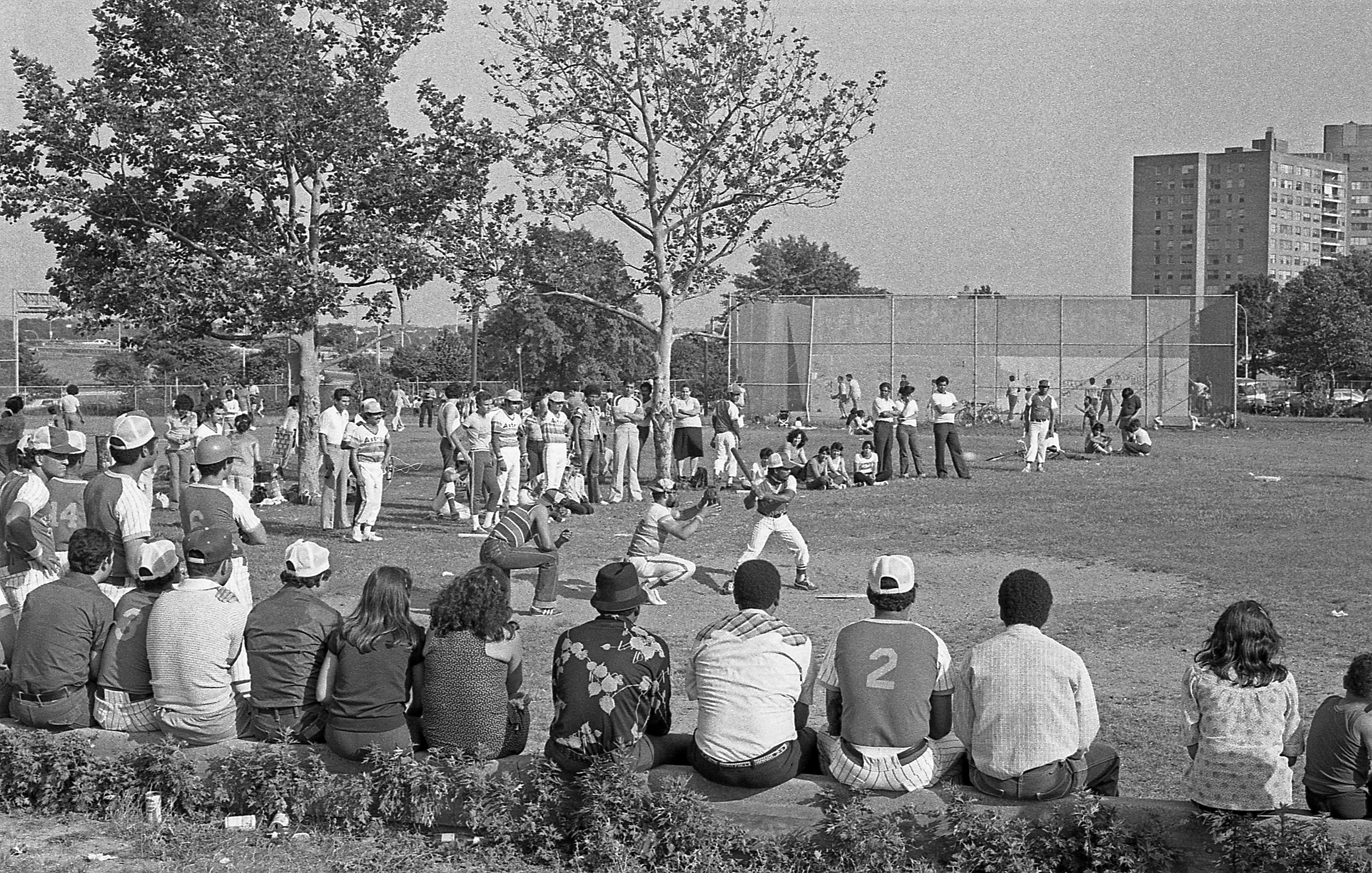 People watching a ball game outside
