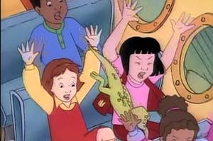 "The students from ""The Magic School Bus"" screaming with their arms in the air while riding the school bus"
