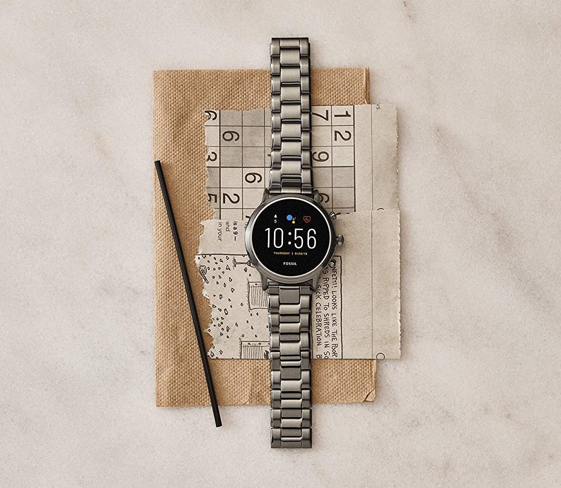 The watch pictured on a jute mat and Sudoku puzzle.