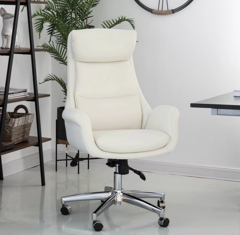 White swivel office chair with silver, wheeled legs