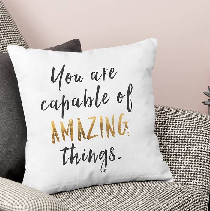 """White cushion cover with text """"You are capable of AMAZING things."""""""
