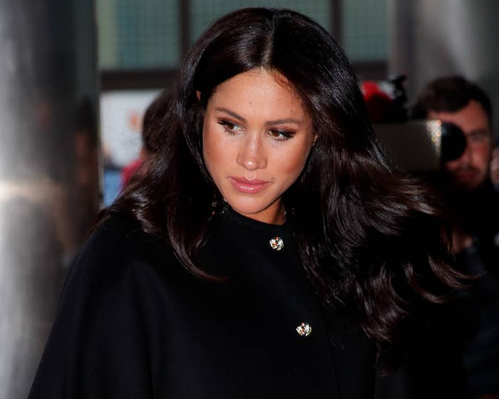 Meghan looks glum while walking to an event