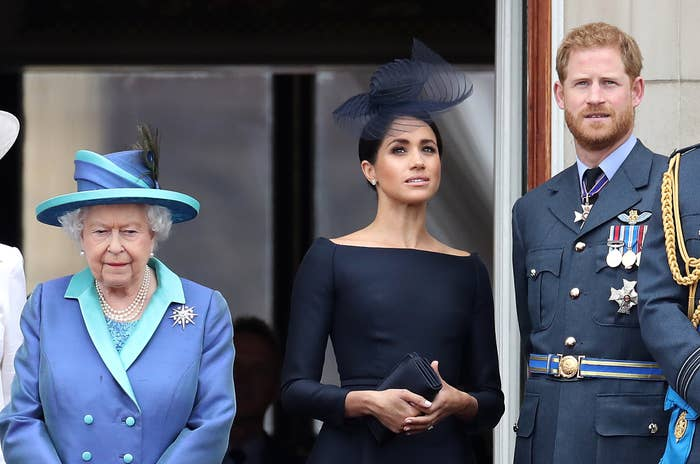 Meghan and Prince Harry stand near Queen Elizabeth