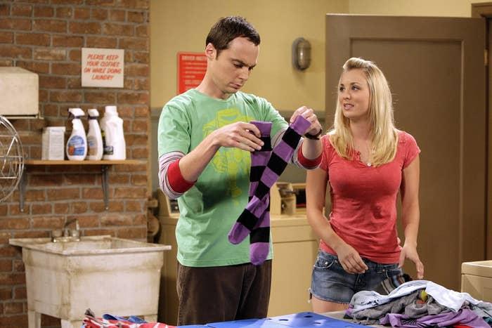 Sheldon (Jim Parsons) and Penny (Kaley Cuoco) folding laundry on The Big Bang Theory