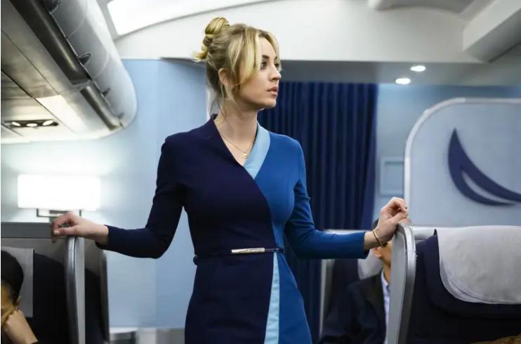 Cassie (Cuoco) on a plane in The Flight Attendant