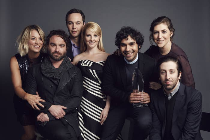 The cast of The Big Bang Theory posing with an award