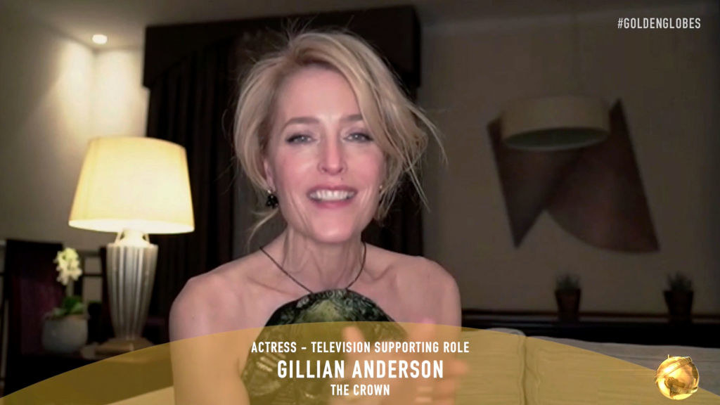 """Gillian Anderson smiling during the virtual Golden Globes, with the text """"Actress — television supporting role, Gillian Anderson, The Crown"""""""