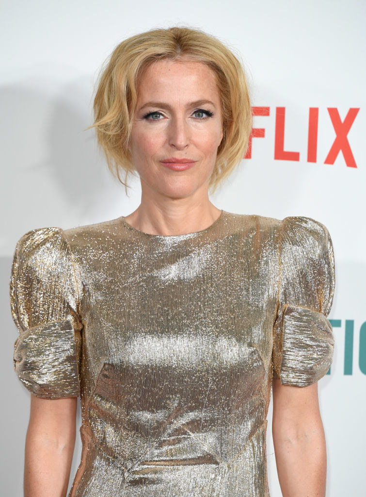 Gillian Anderson posing at a press event