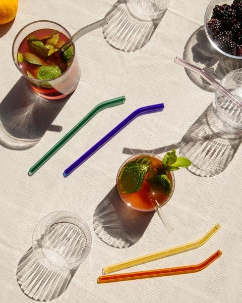 straws in green, blue, clear, yellow, and amber