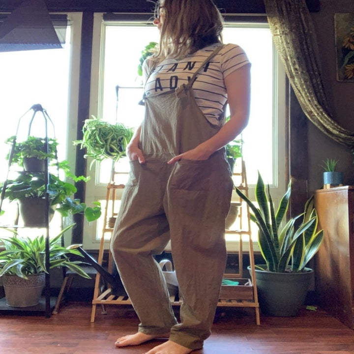 Reviewer wearing taupe overalls