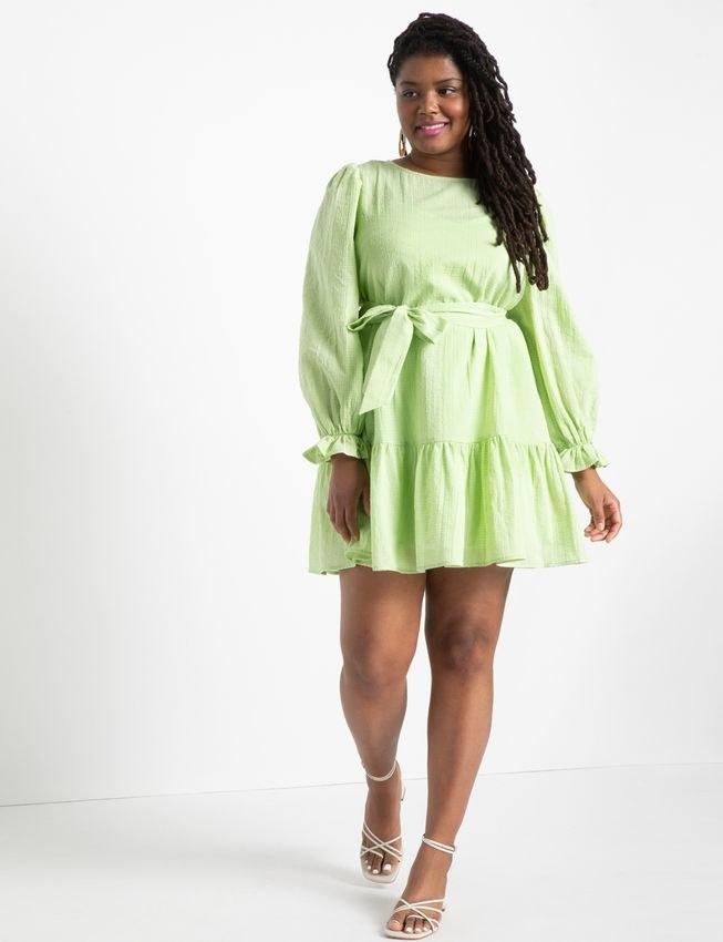 model in long-sleeve green tiered flowy mini dress