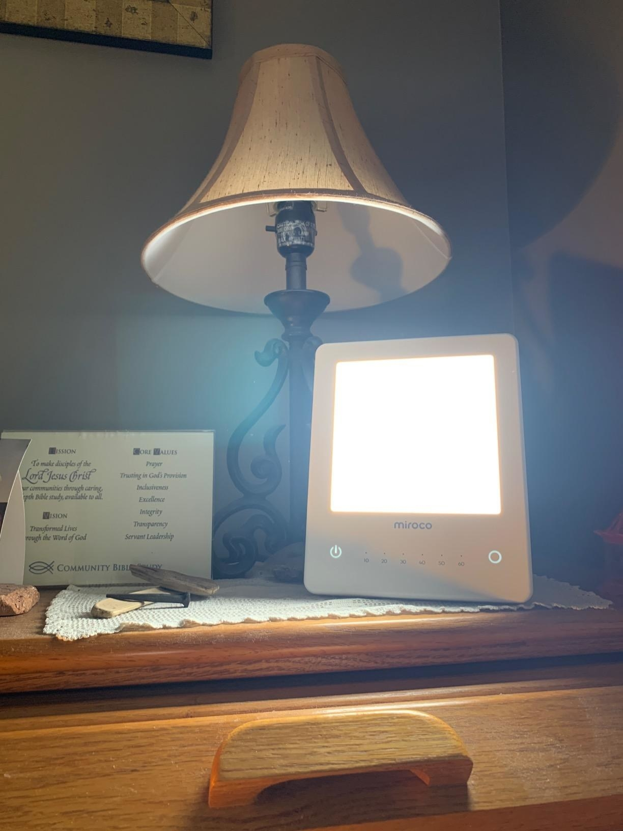 Reviewer photo of light therapy lamp on bedside table