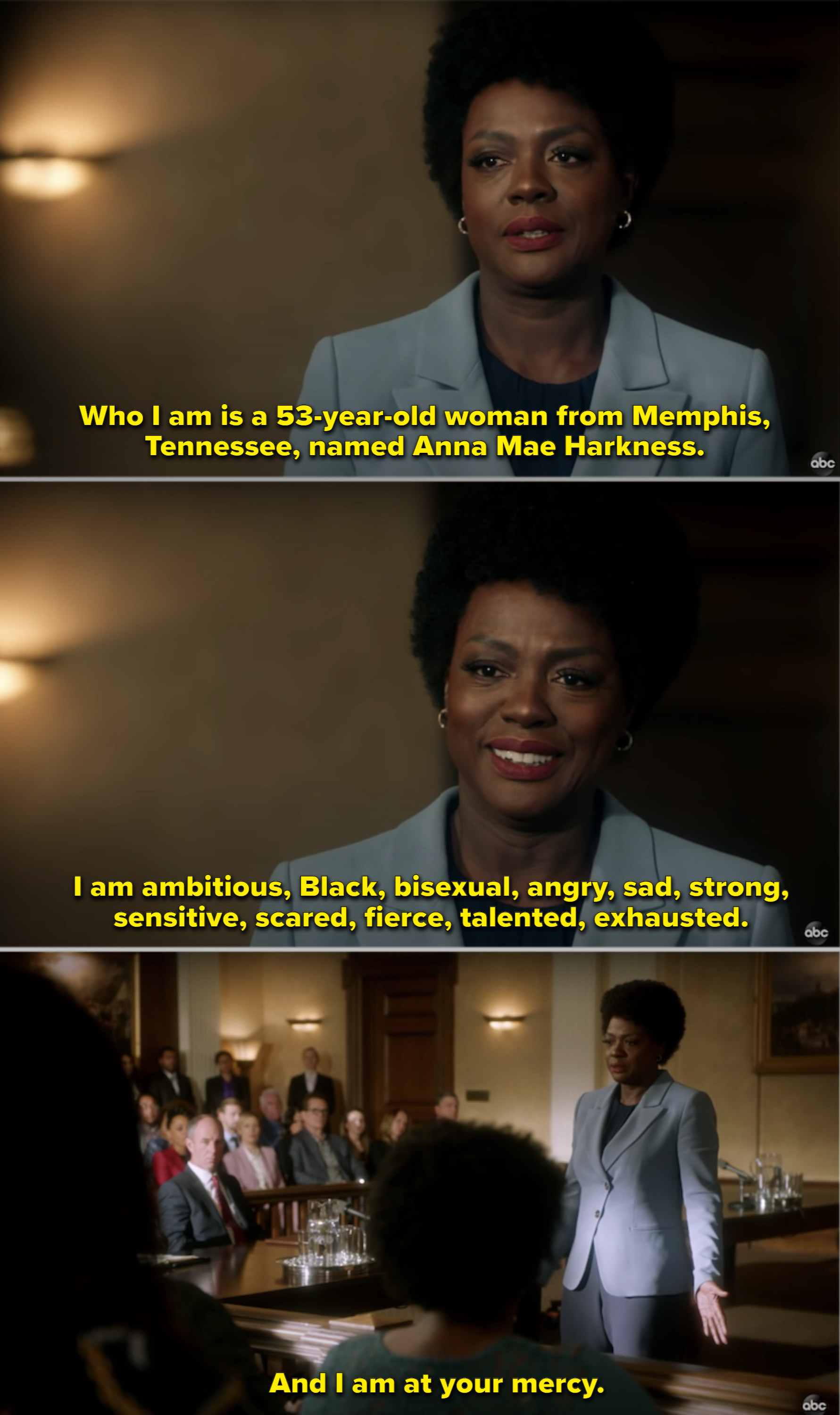 Annalise wearing a grey suit and speaking to the jury in court