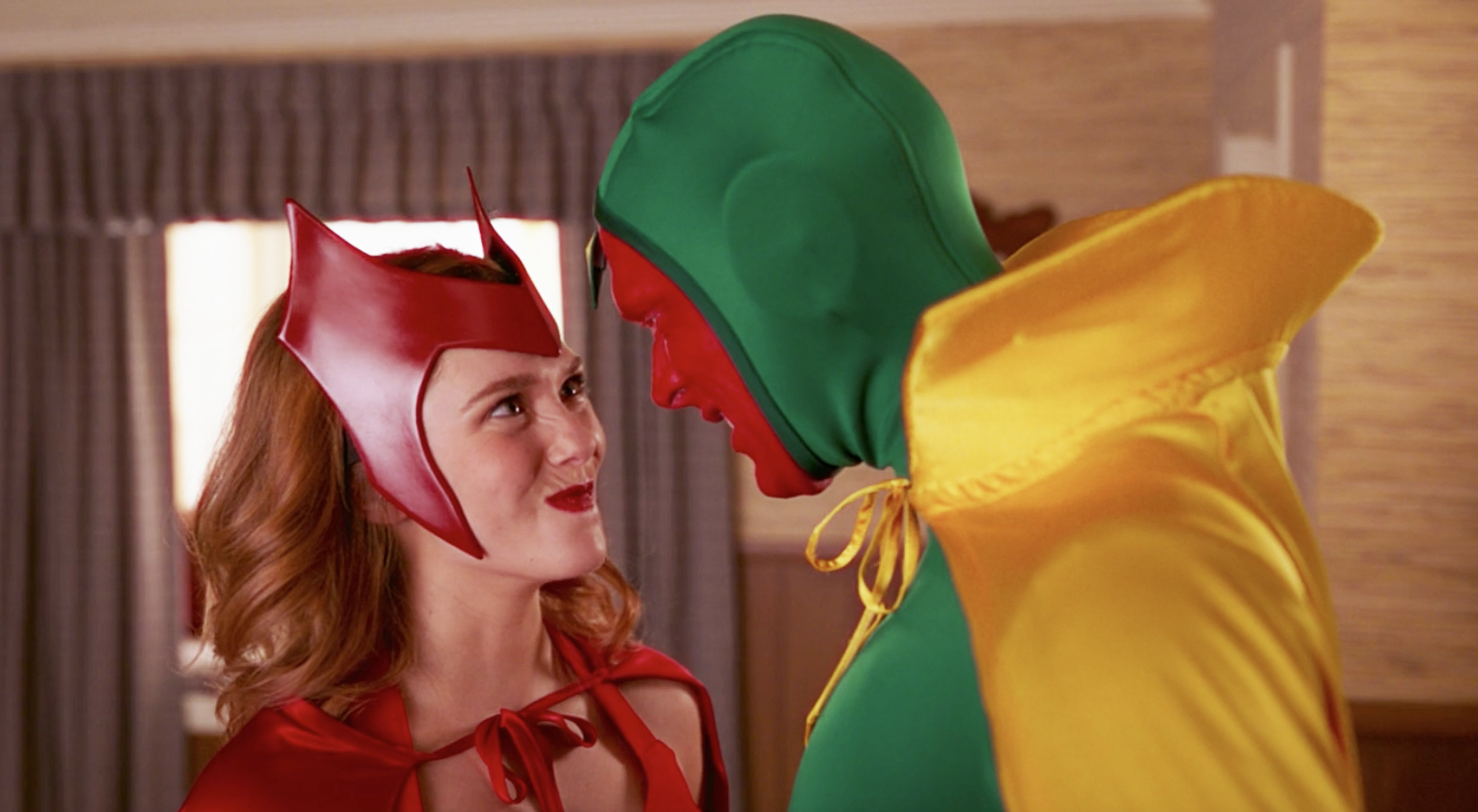 Wanda and Vision dressed up in Halloween costumes in a scene from WandaVision