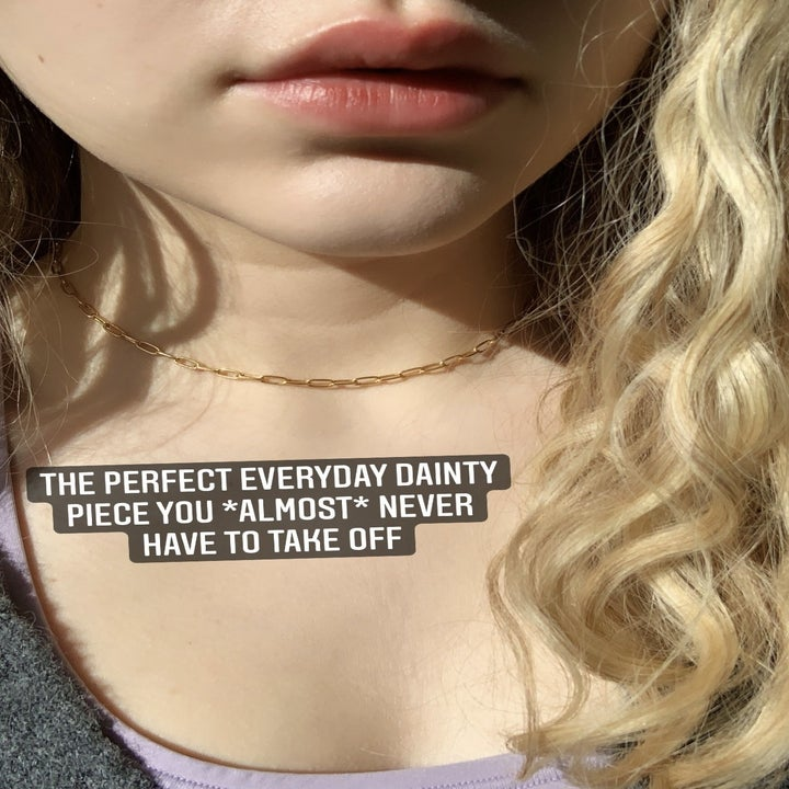 """The necklace worn at choker length on the reviewer with text """"the perfect everyday dainty piece you almost never have to take off"""""""