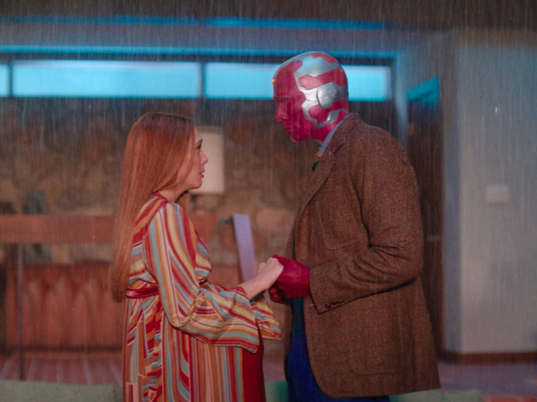 Wanda and Vision standing in the rain in Episode Three
