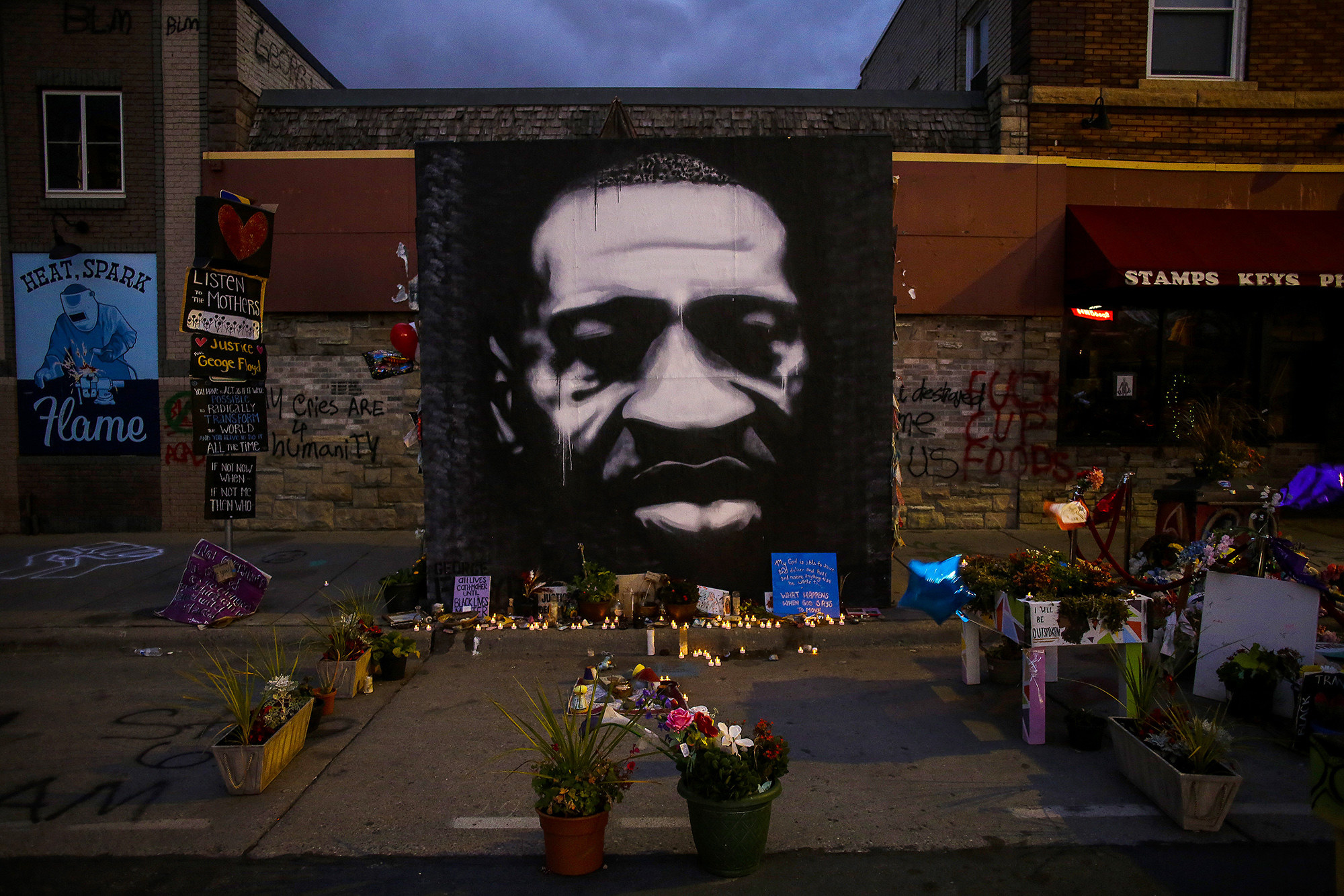 The George Floyd memorial outside Cup Foods, featuring a mural of Floyd's face, candles, and flowers