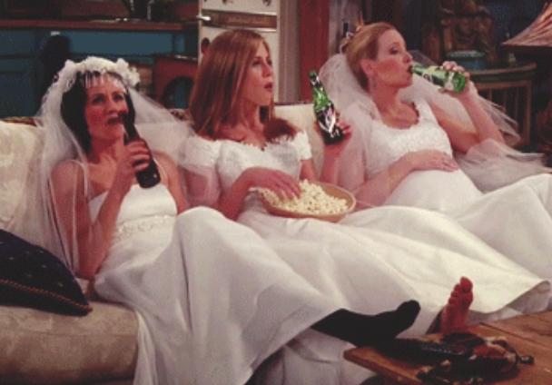 Monica, Rachel, and Phoebe wearing wedding dresses on friends
