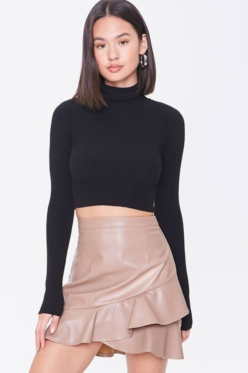 Model wearing the skirt in the color Taupe
