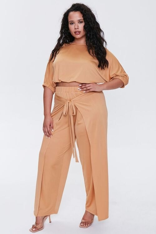 Model wearing the crop top and pants set in the color Camel