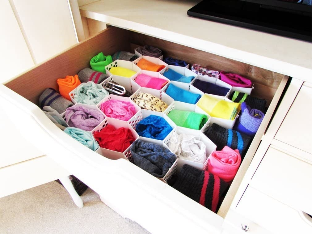a drawer with the organizer in it and sorted socks and underwear