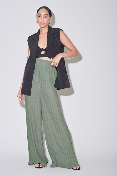 Model wearing the pants in the color Sage