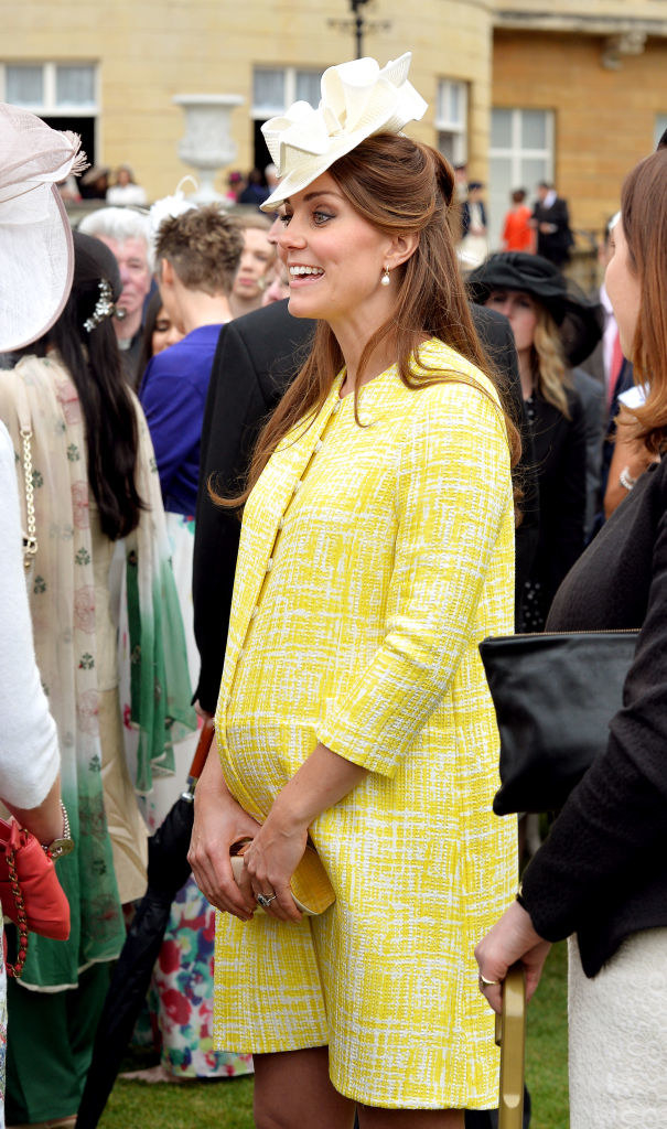 Kate Middleton having a conversation at an event during her pregnancy