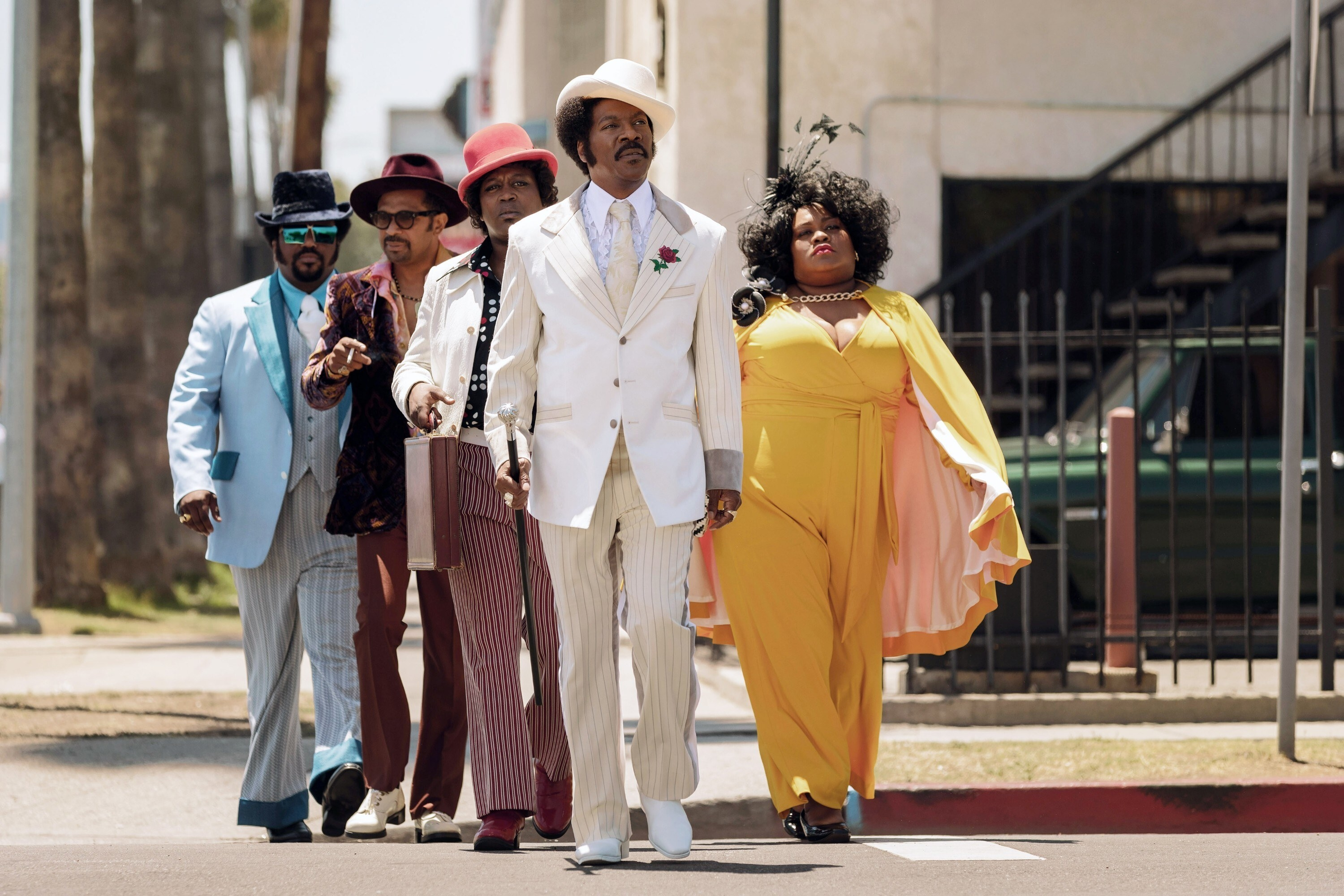 Craig Robinson, Mike Epps, Tituss Burgess, Eddie Murphy as Rudy Ray Moore, Da'Vine Joy Randolph walking in a scene from the film DOLEMITE IS MY NAME