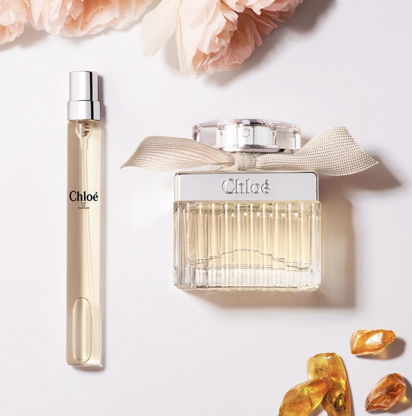A powdery floral perfume in a rollerball and perfume spray