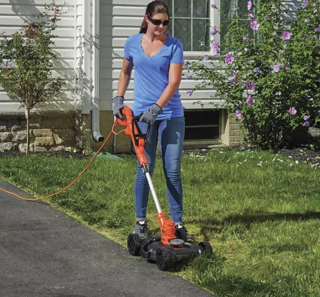 A person mowing their lawn