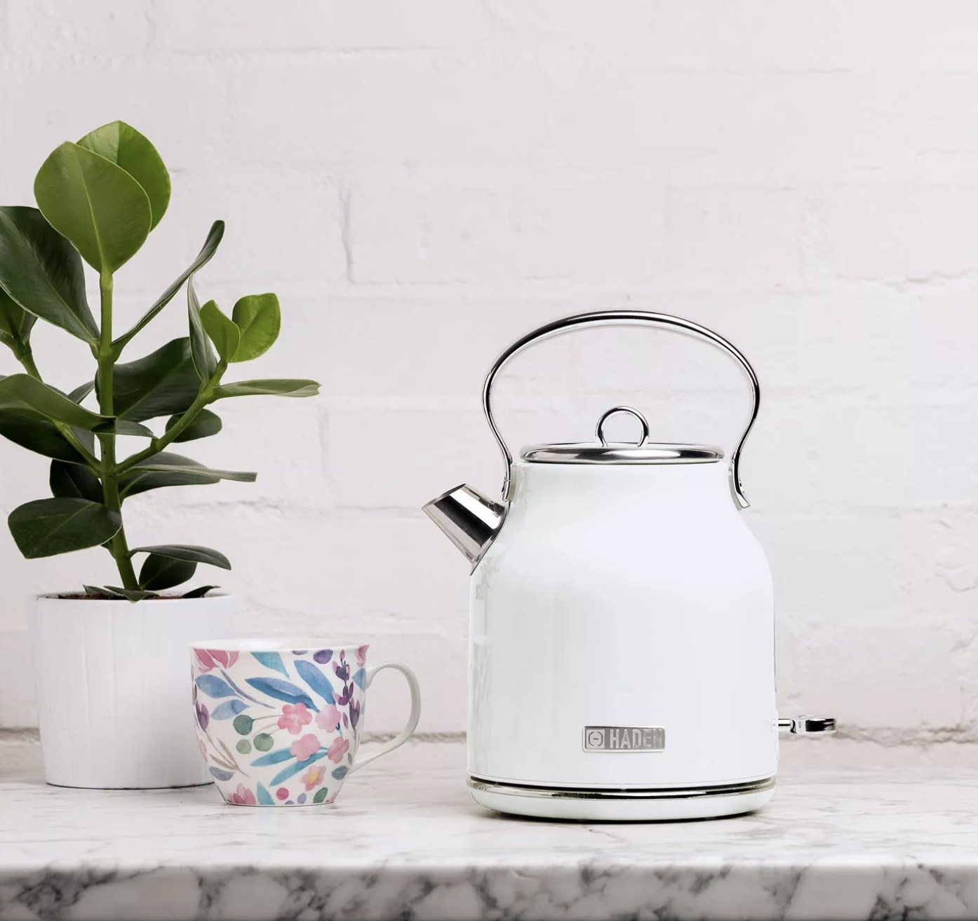 A white tea kettle