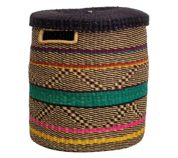 the woven hamper is a mix of tan, yellow, green, pink, and blue line designs