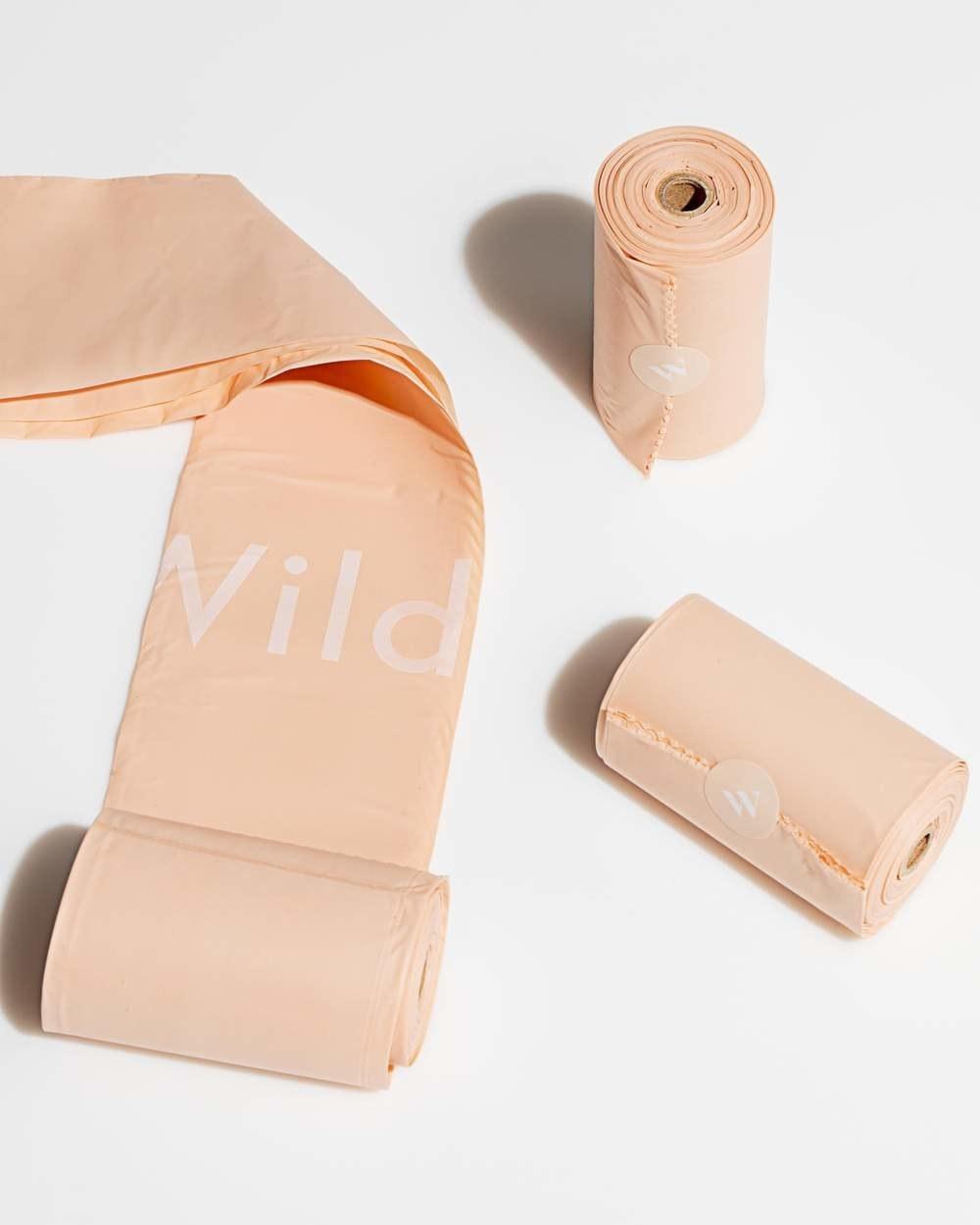 three roll of peach poop bags